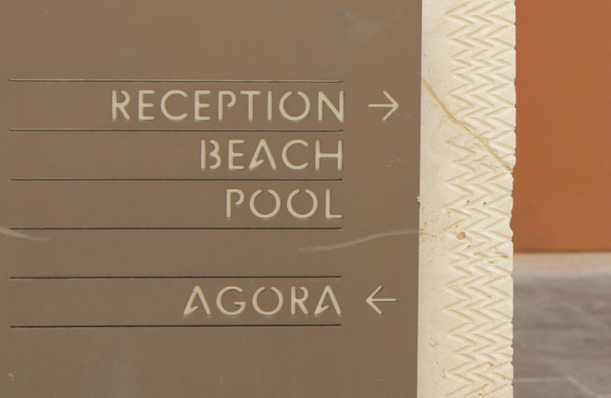 Costa Navarino Typography: Direction Sign